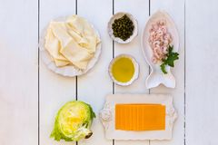 Ingredients for puff pastry with shrimps, cheese and capers. Topview shot of ingredients for pastry with shrimps, cheese, capers, olive oil and thin flatbread Royalty Free Stock Image