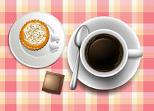 A topview of a table with a coffee, cookie and a creamer Stock Photos
