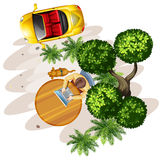 A topview of a table with a man, a tree and a vehicle Royalty Free Stock Photos