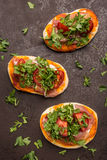 Topview on three little pizza with tomatoes Stock Images