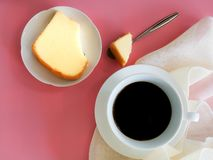 Topview white cup of black coffee served with slice butter cake on dish with pink background. Aroma, caffeine, bakery, spoon, concept, beverage, drink, fresh royalty free stock photos