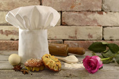 Toque with bakery and pink rose Stock Image