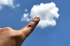 Toque da mão o céu imagens de stock royalty free