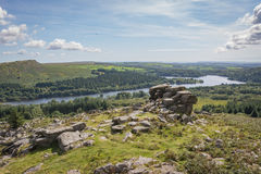 Tor overlooking the lake. View from Leather Tor on Dartmoor looking towards Burrator Reservoir Stock Images