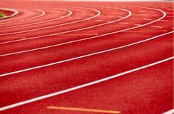 Tor wyścigów konnych w czerwieni Zdjęcia Royalty Free
