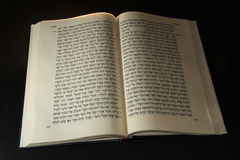 Torah. Hebrew Bible open to the middle with pages showing hebrew letters in the Torah which is also called the Pentateuch stock image