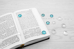 Torah book and precious stones Stock Photo