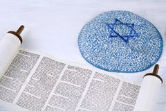 Torah with knitted kippah. Torah with kippah on wooden background. Jewish religion concept royalty free stock photo