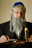 Torah pointer. Old jewish man with beard reading with a torah pointer Royalty Free Stock Photos