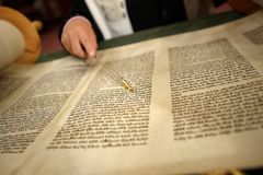Torah reading. Open torah with yad pointing Royalty Free Stock Image