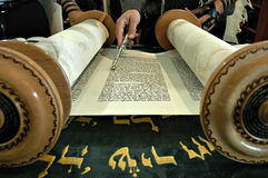 Torah reading in a synagogue. With a hand holding a silver pointer showing the hebrew letters Stock Photography