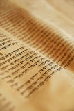 Torah Scroll. Close up of ancient Hebrew writing in a Torah scroll Stock Images