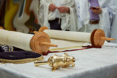 Torah scroll and gold cap with a bells Stock Image