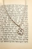 The Torah and silver chain with magen david stock photography