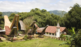 Toraja village. With traditional houses and a church in Toraja, Sulawesi, Indonesia Stock Images