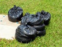 Torba na śmiecie w ogródzie Zdjęcie Royalty Free