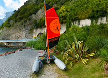 Torbole, Italy - September 21, 2014: Lake Garda beach with tourists Royalty Free Stock Image