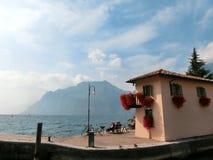 Torbole, Italy - September 21, 2014: Lake Garda boardwalk with houses, tourists Stock Photos