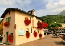 Torbole, Italy - September 21, 2014: Lake Garda boardwalk with houses, tourists Stock Image