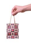 torby ręki mienie odizolowywający papierowy zakupy Zdjęcia Stock