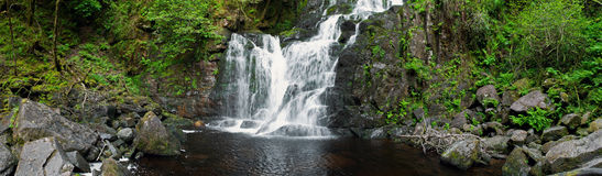 Torc waterfall. Stunning Torc waterfall in the Killarney National Park, Ireland (panoramic picture with 180 angle view Stock Images