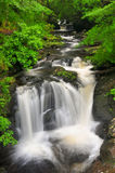 Torc waterfall. Is a waterfall at the base of Torc Mountain, about 5 miles from Killarney in County Kerry, Ireland. The falls are one of the landmarks on the Stock Photo
