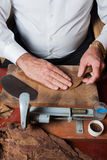 Torcedor rolling hand made cigars Stock Photo