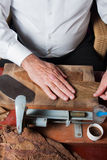 Torcedor rolling hand made cigars Royalty Free Stock Photo