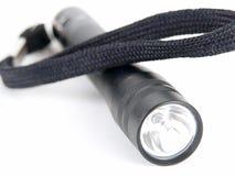 Torch. A pocket flashlight stock photography