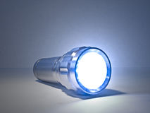 Torch. Concept image of a shining torch against a plain background Royalty Free Stock Photography