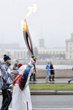 Torch bearer Sochi 2014 in Saint Petersburg, Russia Royalty Free Stock Images