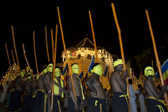 Torch bearers wait for the start of the Esala Perahera procession in Kandy in Sri Lanka. Stock Photos