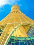 The Torch Doha. Doha, Qatar - February 21, 2019: bottom view of the Aspire Tower luxury 5-star hotel or The Torch Doha in Aspire Park located in the Aspire Zone royalty free stock photos
