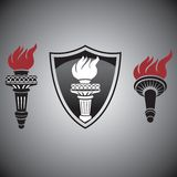 Torch. With fire signs and symbols Stock Images