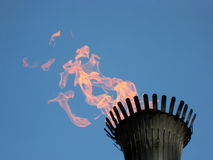 Torch flame. On blue sky Royalty Free Stock Photography