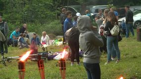 Torch flame and people celebrate midsummer day stock footage