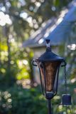 Torch in a garden with blurry background of house royalty free stock images