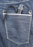 Torch in jeans pocket Royalty Free Stock Image