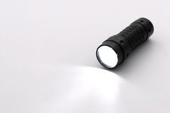 Torch Light. Black LED torch light that is lit up stock images