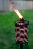 Torch Light. In the backyard with fence. Smoke and fire Stock Image