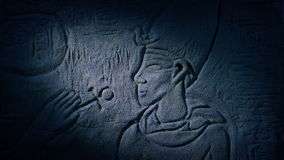 Torch Lights Up Egyptian Carving Of Man