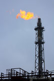 Torch is lit on tower refinery Royalty Free Stock Photo