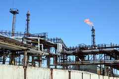 Torch is lit on tower refinery Stock Photography