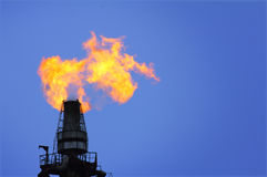 Torch is lit on tower refinery. Air pollution royalty free stock images