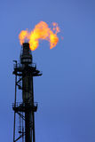 Torch is lit on tower refinery. Air pollution royalty free stock photos