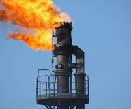 Torch system on an oil field Royalty Free Stock Photo