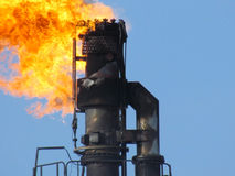 Torch system on an oil field Stock Images