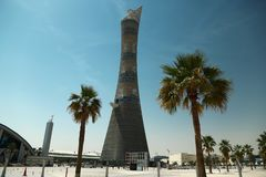 Torch tower and Khalifa stadium notice board in Aspire Zone, Doha, Qatar. QATAR, DOHA, MARCH 26, 2018: Torch tower or The Torch Doha, also known as Aspire Tower royalty free stock photos