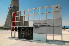 Torch tower and Khalifa stadium notice board in Aspire Zone, Doha, Qatar. QATAR, DOHA, MARCH 26, 2018: Torch tower or The Torch Doha, also known as Aspire Tower royalty free stock image