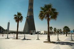 Torch tower and Khalifa stadium notice board in Aspire Zone, Doha, Qatar. QATAR, DOHA, MARCH 26, 2018: Torch tower or The Torch Doha, also known as Aspire Tower royalty free stock photography
